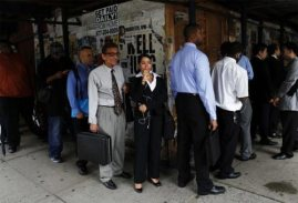 Job seekers in an unemployment line.